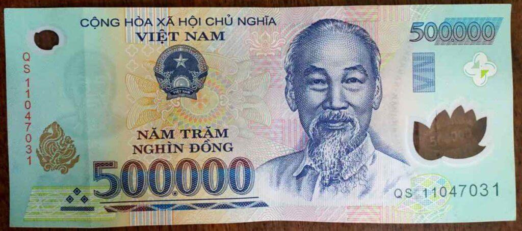"""Half-million Dong banknote. Ho Chi Minh (""""Uncle Ho"""") is pictured on every bill."""